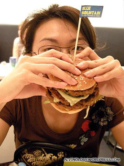 Rachel wolfing down a Blue Mountain burger