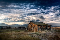 Bitterroot Valley barn (Jeff Engelhardt) Tags: november blue winter sky texture abandoned broken clouds barn rural canon skyscape montana farm side hamilton neglected wideangle east missoula worn damage weathered shack hdr highdynamicrange 10mm ndfilter bitterroot photomatix stevensville bitterrootvalley 40d novemer biggerisbeautiful