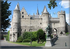Medieval Castle Het Steen - Antwerp, Belgium (Batikart ... handicapped ... sorry for no comments) Tags: burgsteen hetsteen castle burg building gebude haus house medieval mittelalter middleage fairytale mrchenhaft himmel sky wolke cloud blue blau sehenswrdigkeit sightseeing scenic fairytalecastle architektur architecture cityview stadtansicht frhling frhjahr spring juni june antwerp antwerpen europe europa belgien belgium westflandern flanders canon canonpowerhot canonpowershota610 a610 viewonblack geotagged batikart 2009 vacation urlaub vacanze travel holiday window newgoldenseal roof battlement sun light door path way tree meadow urban city sculpture green grey arch flag lamp street road 200faves