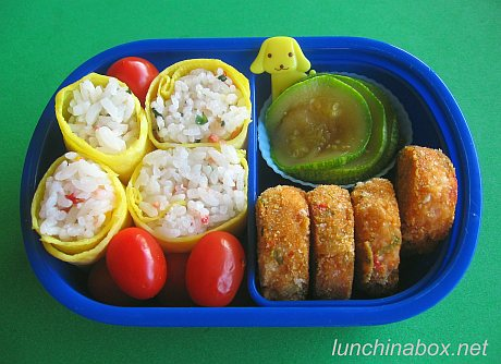 Egg-wrapped onigiri lunch for preschooler
