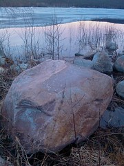 Stone by icy waters