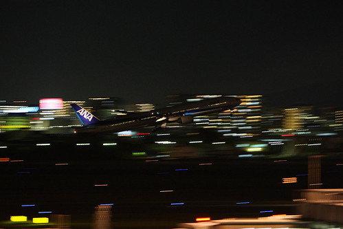 ANA's B777-300 taking off in the night