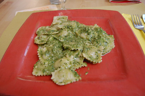 tofu/asparagus ravioli with fresh pesto (the white pieces are pine nuts and garlic)