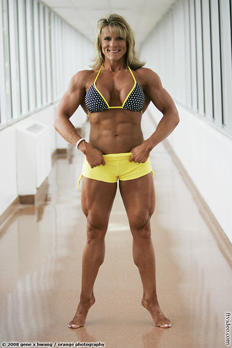Angela Rayburn Flexes Thighs and Calves