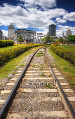 on the tracks to the Old Montreal - Spring Edition - HDR (David Giral | davidgiralphoto.com) Tags: old sky urban canada skyline spring nikon cityscape cloudy quebec montreal tracks fluffy rail rails d200 hdr sigma1020mm 3xp nikond200 tthdr