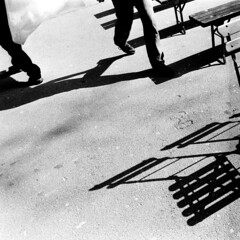 Ljubljana (Peter Gutierrez) Tags: street city shadow people urban bw white black film public square person photo chair europe european republic shadows chairs pavement sidewalk peter slovenia ljubljana gutierrez slovenija eastern folding republika slovenian slovenians peter petergutierrez gutierrez