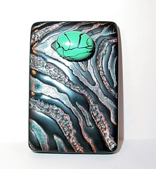 Ebony and Faux Turquoise Textured Brooch (Lynda Moseley Diva Designs Inc) Tags: black texture animal print handmade turquoise metallic teal brooch jewelry powder polymerclay exotic clay copper bead designs diva ebony pendant embossed focal challengeentry