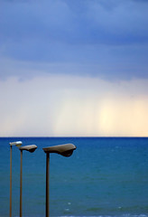 It's raining over there (redbanshee) Tags: wonderworld cielo mare sky sea clouds nuvole rain pioggia showers lamp lampione blu blue rothko passoscuro darkstep geotagged blueribbonwinner redbanshee dani passooscuro photo foto fotografia pic picture redbanhsee image immagine photography passo oscuro colorannoaprile