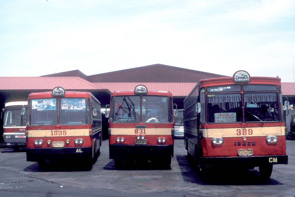 Philippine Rabbit Bus Lines Mitsubishi CAW-662 (1625), unknown types CVF-701 (1535) CVU-783 (831) and Isuzu CVC-652 (389) bus terminal, Tarlac Tarlac, Philippines.