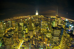 Planet New York (Jrg Dickmann) Tags: city nyc newyorkcity usa ny newyork topf25 night america skyscraper buildings geotagged lights topf50 unitedstates manhattan rockefellercenter fisheye explore empirestatebuilding empirestate canon5d bigapple 15mm topoftherock sigma15mm jrgdickmann geo:lat=40757953 geo:lon=73978436