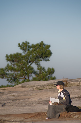Woman Studying On Stone Mountain