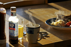 English Breakfast (s0ulsurfing) Tags: uk morning light england food orange hot english cooking cup glass breakfast table cuisine bacon bottle hp yum ketchup tea britain sauce juice toast beverage plate steam foodporn meal mug eggs british hungry feed eats 2008 mmmm grub cutlery tomatosauce scrambled iatethis tuck cuppa sustenance brownsauce brekky breaky squeezy englishness s0ulsurfing aplusphoto