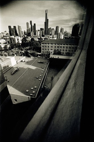 city urban blackandwhite bw film rooftop skyline architecture clouds 35mm nikon cityscape skyscrapers grain perspective australia melbourne victoria epson 135 polarizer vignetting windowsill vignette eurekatower stkildard f90x urbanlandscape redfilter polariser 25a v700 macophot tokina17mmf35atx macocube400c icanseeformetres