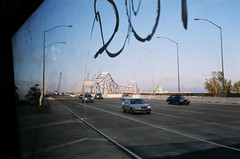Looking back at Oakland while merging to San Francisco (juicyrai) Tags: sanfrancisco bridge bus film minolta muni baybridge himatic i80 yerbabuena ybi yerbabuenaisland 7sii minoltahimatic7sii himatic7sii 108treasureisland