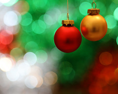 Christmas green, gold & red (Mukumbura) Tags: santa christmas new xmas bon decorations red party colour tree green glass crimson glitter dinner canon silver ball scarlet weihnachten reindeer fun happy gold navidad globe colours dof bright bokeh year vivid balls noel depthoffield celebration ornament ornaments tinsel yule santaclaus grotto merry tradition sleigh festivities natale nativity nadal unbelievable baubles yuletide joyeux buon festiveseason frhliche eos30d canonef100mmf28macrousm   theperfectphotographer gettyholidays2010
