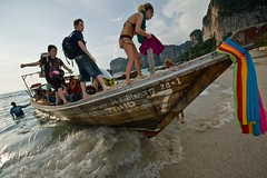 Backpacker arriving at Tailay beach by boat