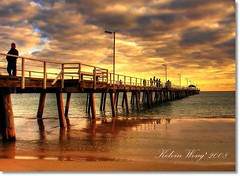 Henley Beach Jetty (Kelvin Wong (Away)) Tags: sunset sky people cloud seascape reflection beach water yellow bravo jetty australia adelaide southaustralia henleybeach xxxooo aplusphoto holidaysvacanzeurlaub favemegroup9 kelvinwong piscesromance henleyjetty fistqaulity