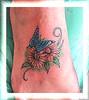 tatuagem flores e borboleta no pe 2 TARZIA TATTOO -