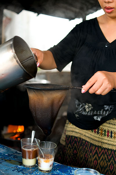Making coffee Lao-style at Pasaneyom Coffee Shop, Luang Prabang