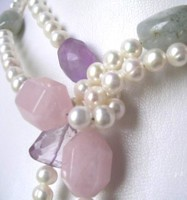Pink rose quartz (seen here with aquamarine and amethyst)
