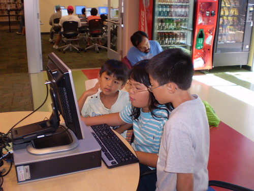 Kids using the computers. by San Jos� Library, on Flickr