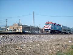 Eastbound Metra commuter train passing the Union Pacific M-19A diesel shop. Chicago Illinois. June 2007.