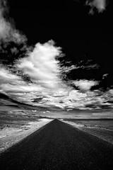 This road must take me somewhere... (Pezti) Tags: summer sky bw cloud white black clouds canon dark landscape eos iceland explore 5d 2008 sumar snæfellsnes ský himinn blackandwhit canoneos5d canonef1740f4l explored svarthvítt