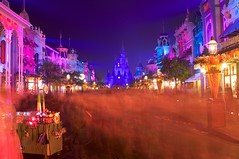 Happy Halloween from Main Street USA (Matt Pasant) Tags: longexposure blur halloween colors canon pumpkin orlando florida ghost disneyworld mickeymouse wdw magickingdom waltdisney mainstreetusa cinderellascastle f7 bootoyou canon40d notsoscaryhalloweenparty disneyphotochallengewinner 5stardisneyaward
