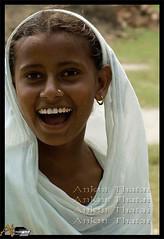 Dupatta- 'lajj da gehna' (Ankur Thatai | A T Images) Tags: india girl smile asian headscarf culture desi sikh punjab schoolgirl sikhism punjabi younggirl villagegirl kudi indiangirl punjaban dupatta chunni mutiyar odhni lughing ruralgirl jalalabadwest atimages photoankurthatai whitedupatta punjbigirl punjabimutiyaar sabhyachaar