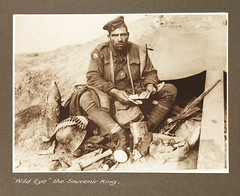"""Wild Eye"", the Souvenir King (National Media Museum) Tags: its soldier wwi rifle helmet shell worldwari and worldwarone british bullets grenade greatwar firstworldwar ammunition anzac armisticeday potatomasher warprize warbooty thegreatwar artilleryshell wildeye softcap johnhines howitusedtobe stahlhelm ammobelt machinegunbelt wartrophy thirdbattleofypres frankhurley polygonwood ammunitionbelt mauser98 thesouvenorking asouvenirking acompany45thbattalion 4thand13thbrigades 2296privatejohnbarneyhines westernfrontbelgium mauserrifle commons:event=commonground2009 potatomashergrenade warprizes"