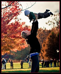 Mother and Child (A - Lo Photo) Tags: park nyc newyorkcity autumn red baby newyork fall colors smile leaves flying nikon child centralpark manhattan mother changing laughter motherandchild d80 nikond80