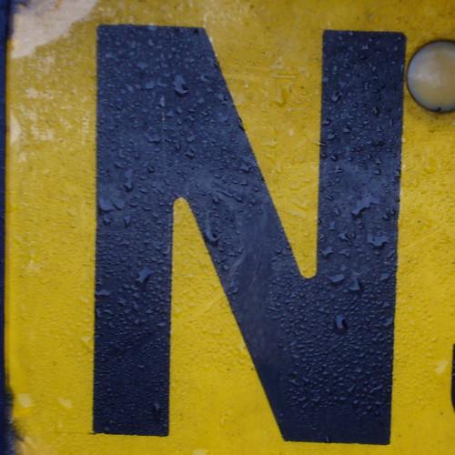 black wet yellow photo n letter oneletter