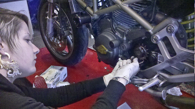 Moto Lady wrenching on Monster Project