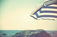 Vintage estival (Joeyful~) Tags: blue light sea summer sun beach umbrella vintage mare estate sole spiaggia luce gettyimages estival estivo ombrellone