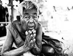 "Grandmother Prays ""in preparation"" (left this world in January 2009) - Phimai, Thailand (Sailing ""Footprints: Real to Reel"" (Ronn ashore)) Tags: people blackandwhite portraits thailand asia theface issan canoneos5d phimai 5photosaday bnritratto aplusphoto february2008pimaiprayinggrandmothersquare"
