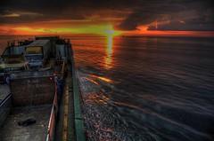 barge (Earljo22) Tags: sunset sea orange clouds boat barge