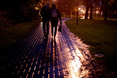 I'll walk you (Chris Beauchamp) Tags: calgary rain canon campus walking holding hands couple university sigma 30mm xti 400d copyrightchrisbeauchamp20072009