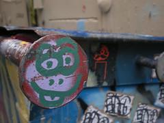 6/9/08 Free Wall (sixheadedgoblin) Tags: dumpster sticker spray scrawl publicart olympiawashington smileyface redi 4thwanklinalley