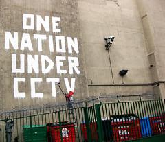 banksy (JapanBlack) Tags: street red england dog london art wall fence one graffiti hoodie paint soho under nation banksy police cctv illegal hood ladder bins policeman
