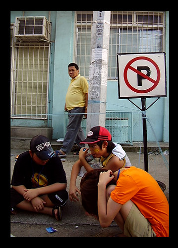 A NO PARKING Sign and A Guy Who Seems to Wonder Why Those Boys Are Sort of Like Parking
