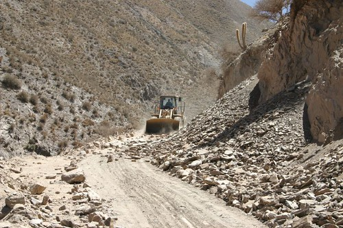 Maquina making the road passable. North of Tupiza, Bolivia.