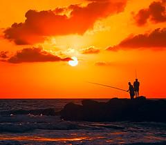 Sunset Fishing (NatashaP) Tags: sunset sea orange sun night fishing nikon fishermen searchthebest silhouettes explore bec bigmomma d40 interestingness170 outstandingshots challengeyouwinner abigfave anawesomeshot superaplus aplusphoto holidaysvacanzeurlaub infinestyle theunforgettablepictures a3b theperfectphotographer pfogold alemdagqualityonlyclub