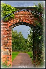 Follow The Path (thingamijig) Tags: flowers wall gardens arch path bricks doorway gateway archway picnik walledgarden coloursplosion veryprettty