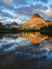 Morning with the Mountains (Michael Bollino) Tags: park morning camping sky mountain lake mountains reflection nature beauty clouds landscape glacier alive impressed glaciernationalpark sinopah twomedicine bigfave abigfave colorphotoaward impressedbeauty absolutelystunningscapes