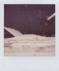 Helter Skelter (Zack the Human) Tags: building metal polaroid sx70 rainyday rusty rainy ladder slippery