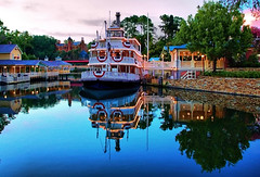 Disney - Night Falls On Liberty Square (Express Monorail) Tags: travel sunset walter vacation usa reflection water america wonder geotagged fun psp orlando nikon florida dusk availablelight magic dream wed elias disney mickey disneyworld fantasy mickeymouse riverboat imagine theme wish orangecounty wdw waltdisneyworld walt magical kissimmee themepark attractions waltdisney waterreflection libertysquare thehauntedmansion wdi lakebuenavista imagineering libertybelle d40 waltdisneyworldresort disneypictures disneyparks disneypics expressmonorail disneyphotos paintshopprophotox2 joepenniston disneyphotography disneyimages geo:lat=28419121 geo:lon=81583091