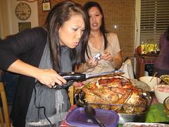 Cori pretends to cut turkey