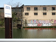 DEP Floating Boom and Graffiti Mural, Bronx River, New York City (jag9889) Tags: city nyc ny newyork river graffiti bronx south boom kayaking caution dep 2008 bronxriver y2008 floatable floatingboom jag9889