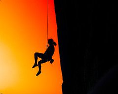 Girl hang by a rope! (Periklis Ripis) Tags: trip travel sunset summer vacation people orange woman mountain holiday black color fall sports nature girl silhouette sport rock fun island greek photography climb holidays play pentax action extreme vivid rope greece climbing leisure recreation gym vacations hang evia  supershot xiliadou platinumphoto anawesomeshot infinestyle periklis ripis platinumsuperstar  phvalue saariysqualitypictures   periklisphotography periklisphotographycom