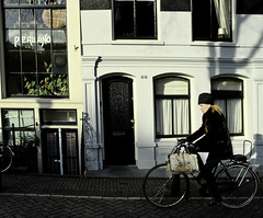 a passing fashion (nardell) Tags: light holland amsterdam fashion bike shadows bikes streetscene 66 bicycles handbag peruano fashionable